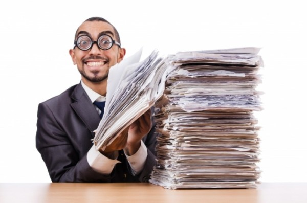 Happy-Man-with-too-much-Work_shutterstock-700x463